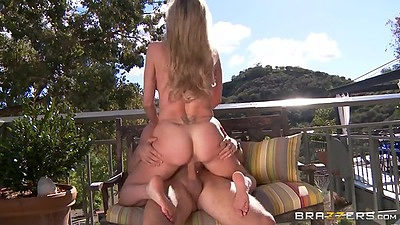 Smoking hot milf cowgirl on the terrace outdoors Brandi Love