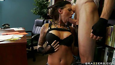 Hot busty brunette slut sucking by book shelf