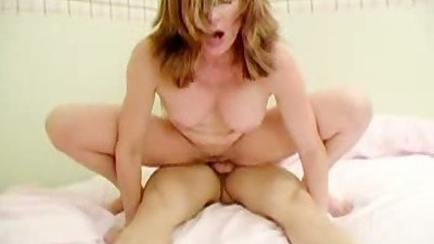 Mother and daughter share a cock in group sex