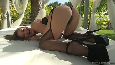 Showing her perfect porn star ass solo posing outdoors Dani Daniels