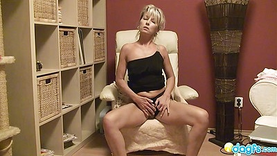 Milf getting naked and sitting in the chair solo
