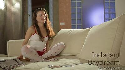 Brunette solo teen Anita getting naked on sofa