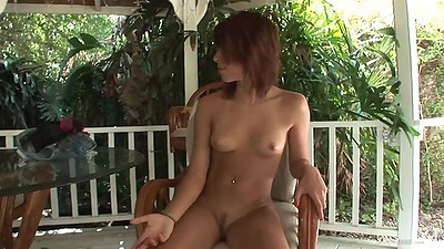 Amateur with really small tits sits naked in chair